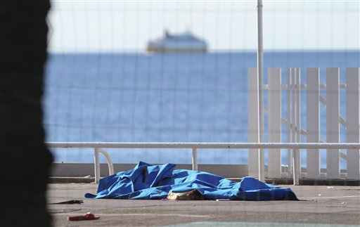 Bodies of victims covered by sheets at the scene of an attack in Nice, southern France, Friday, July 15, 2016, a day after a large truck mowed through revelers gathered for Bastille Day fireworks in Nice, killing at least 84 people as it bore down for more than a mile along the Riviera city's famed waterfront promenade. (AP Photo/Luca Bruno)
