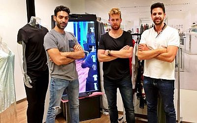 Yossi Shriki, Asaf Shapira and Roy Dror of CheckOut Apps in their Tel Aviv office. (Courtesy)