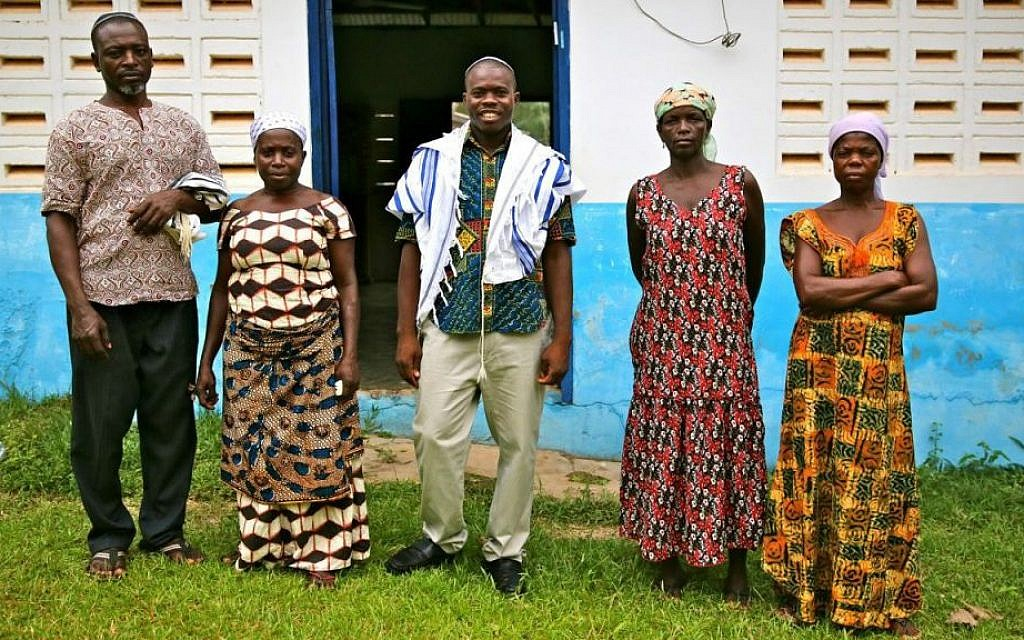 Spiritual leader Alex Armah (center) with community members at shacharit (morning) service at Tifereth Israel Synagogue, House of Israel Jewish Community. New Adiembra, Ghana. February 2014. (Courtesy Jono David)
