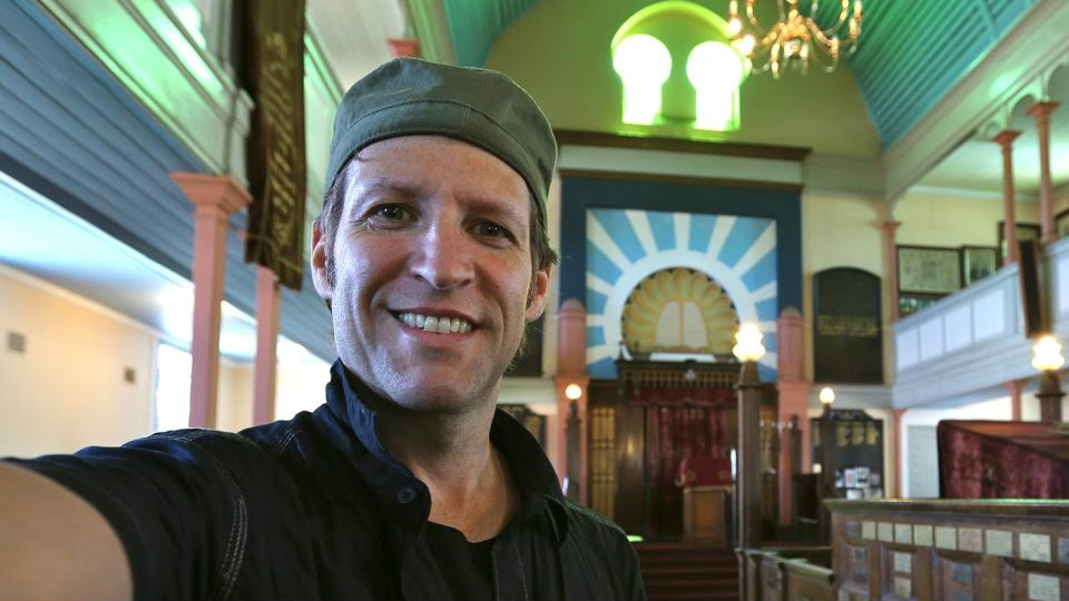 Photographer Jono David in the Jewish Pioneers' Memorial Museum (former Raleigh Street Synagogue) in Port Elizabeth, South Africa. (Courtesy Jono David)