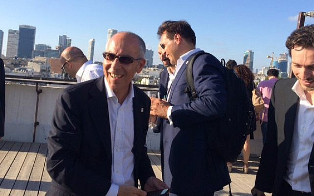 Enel's CEO Francesco Starace on Tel Aviv rooftop with team (Shoshanna Solomon/Times of Israel)