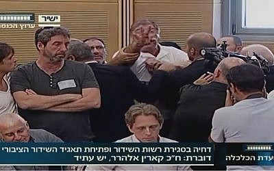 IBA employee Rafi Issachar interrupts a Knesset hearing about the deferral of the founding of a new public broadcasting authority. (screen capture: Knesset Channel)