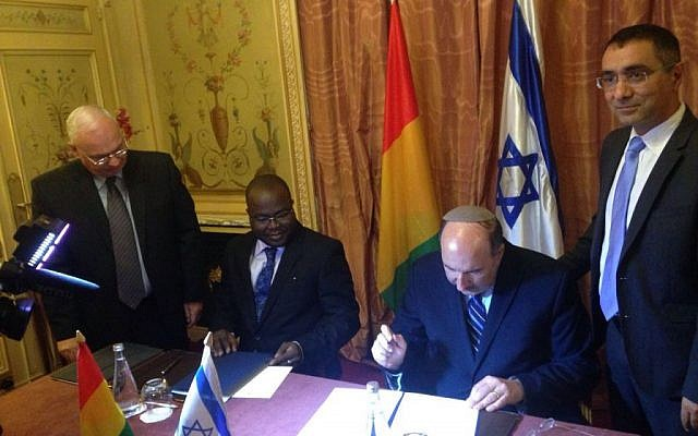 Foreign Ministry director-general Dore Gold (second from right) signs a deal to restore diplomatic ties with Guinea in Paris, France on July 20, 2016. (Courtesy Israel Ministry of Foreign Affairs)