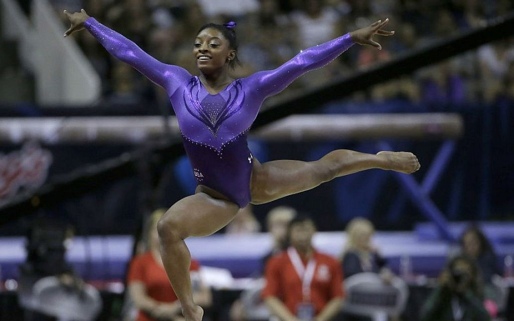 Simone Biles competes on the floor exercise during the women's U.S. Olympic gymnastics trials in San Jose, California, Friday, July 8, 2016. (AP Photo/Ben Margot)