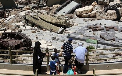 Visitors look at tanks left behind in Lebanon by Israeli forces as they visit the Hezbollah-run 'Tourist Landmark of the Resistance' war museum in Mlita (aka Mleeta) in southern Lebanon on July 12, 2016 (AFP PHOTO / MAHMOUD ZAYYAT)