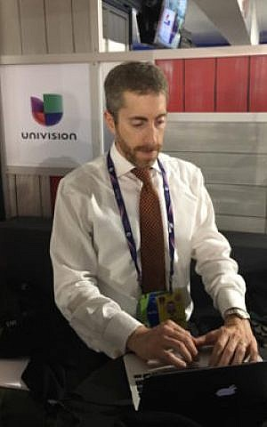 Joel Pollak of Breitbart News working at the Republican National Convention in Cleveland, July 2016. (Ron Kampeas)