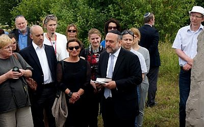 Michael Schudrich, Poland's chief rabbi, reciting a prayer for the victims of the Jedwabne massacre at the town's Jewish cemetery, July 10, 2016. Second from left is Jonathan Greenblatt, the Anti-Defamation League's national director. (Cnaan Liphshiz)