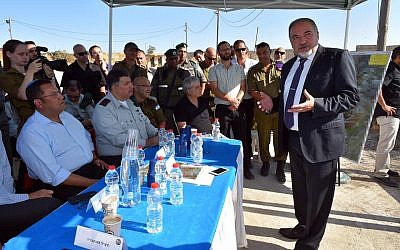 Defense Minister Avigdor Liberman at the Hizme Checkpoint, July 17, 2016, talking to officials about improving conditions at West Bank Crossings into Jerusalem. (Courtesy: Facebook)