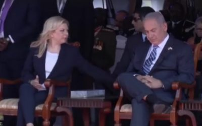 Sara Netanyahu nudges her husband, Prime Minister Benjamin Netanyahu, as he apparently nods off at a memorial service to mark the 40th anniversary of Israel's raid to rescue hostages at Entebbe airport in Uganda on July 4, 2016, which his brother Yoni was killed. (screen capture: Channel 10)