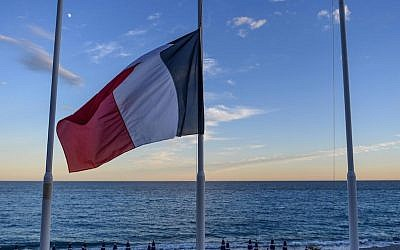 A French flag flying at half-mast at an empty beach on the Promenade des Anglais in Nice a day after a terrorist attack in the French city killed 84, July 15, 2016. (David Ramos/Getty Images)