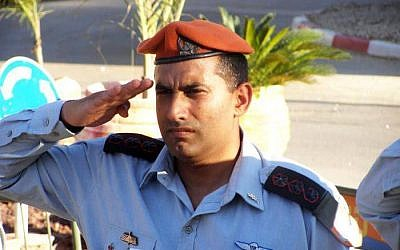 Brig. Gen. Dedi Simchi, chief of staff for the IDF's Home Front Command, salutes during a military ceremony in an undated photograph. (IDF Spokesperson's Unit)