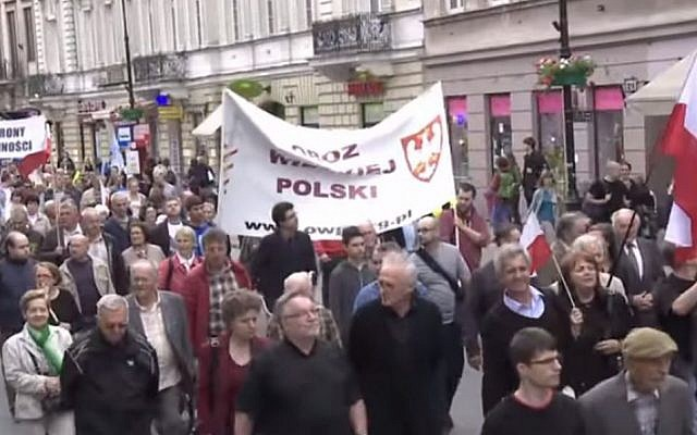 Poles march in Warsaw in 2015 to to commemorate those killed by the Ukrainian Insurgent Army  (YouTube screenshot)