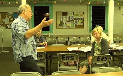 Russell Ruderman talking about organic farming at a town hall meeting on December 12, 2013. (Screenshot: YouTube)