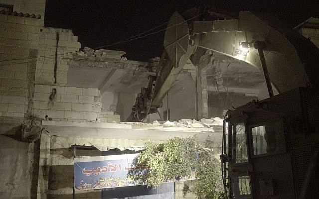 Security forces destroying the home of Palestinian Balal Abu Zeid who was convicted of assisting in a terror attacked during which a border guard was killed. Abu Zeid's home in Qabatiya was demolished July 18, 2016. (IDF spokesperson)