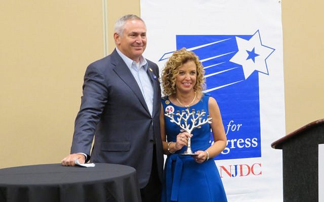 Marc Stanley, past president of the National Jewish Democratic Council, presents an award to Debbie Wasserman Schultz, former chairwoman of the Democratic National Committee. (Ron Kampeas/JTA)