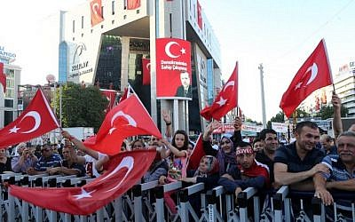 Pro-Erdogan supporters wave Turkish flags as they gather during a rally against the military coup at Kizilay Square in Ankara, on July 25, 2016. (AFP Photo/Adem Altan)
