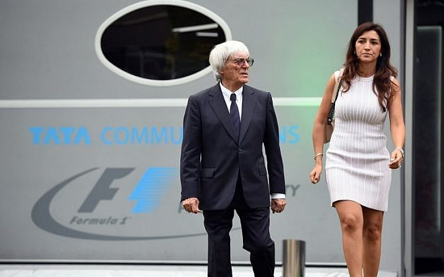 Formula One boss Bernie Eccleston and his wife, Fabiana Flosi in Singapore on September 18, 2014. (AFP PHOTO / TOSHIFUMI KITAMURA).