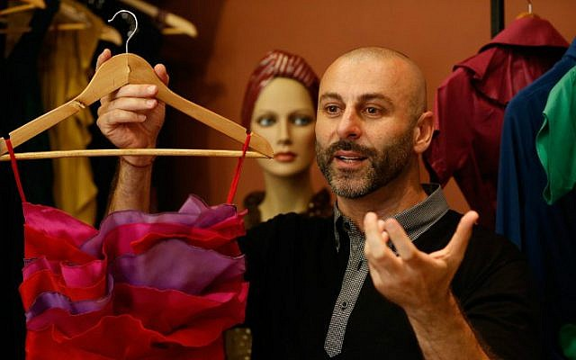 Palestinian American fashion designer Rami Kashou shows one of his designs during a fitting session at a pop-up shop in the West Bank city of Ramallah on July 27, 2016. (Abbas Momani/AFP)