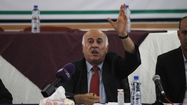 Palestinian Football Association President Jibril Rajoub speaks during a meeting in the Israeli occupied city of Hebron announcing a decision to postpone a rare match between teams from the Gaza Strip and the West Bank, on July 30, 2016. (AFP / HAZEM BADER)