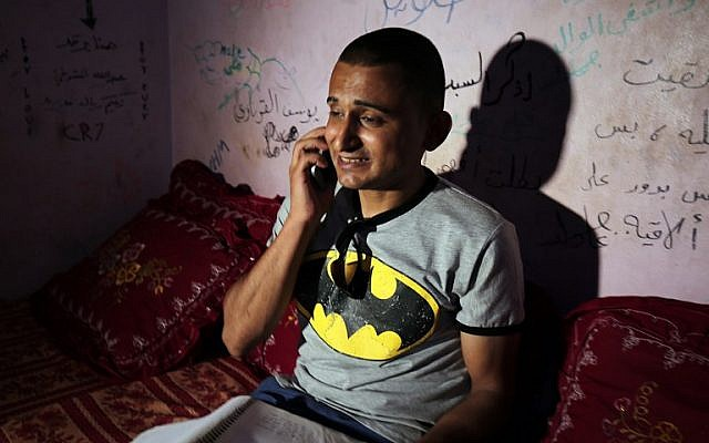 Palestinian singer Adel Meshoukhi speaking on the phone at his home in Rafah in the southern Gaza Strip, July 29, 2016. (AFP/SAID KHATIB)