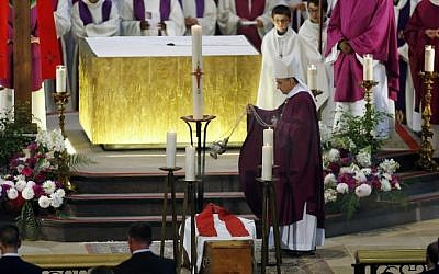 Archbishop of Rouen, Dominique Lebrun blesses Father Jacques Hamel's coffin at the Rouen cathedral in northern France on August 2, 2016. (AFP PHOTO / POOL / CHARLY TRIBALLEAU)