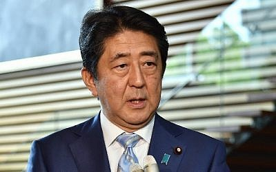 Japan's Prime Minister Shinzo Abe speaks to reporters at his official residence in Tokyo following a ballistic missile launch by North Korea, August 3, 2016. (AFP/KAZUHIRO NOGI)