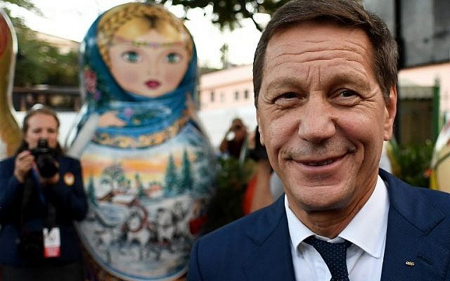 President of the Russian Olympic Committee Alexander Zhukov poses in front of a matryoshka doll at the opening ceremony of the 2016 Olympic Games in Rio de Janeiro, Brazil, on August 4, 2016. (AFP/Kirill Kudryavtsev)