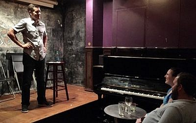 Muslim American comedian Dean Obeidallah, who was born in New Jersey to an Italian mother and a Palestinian father, performs at Jimmy's N° 43, a bar and club in the East Village, in New York on July 29, 2016. (Thomas Urbain/AFP)