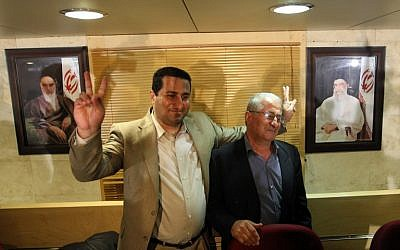 "This photo taken on July 15, 2010 shows Iranian nuclear scientist Shahram Amiri standing with his father upon his arrival at Imam Khomeini Airport in Tehran. Iran, announced on August 7, 2016, that it had executed Amiri for handing over ""top secret"" information to the United States (AFP PHOTO / Atta KENARE)"