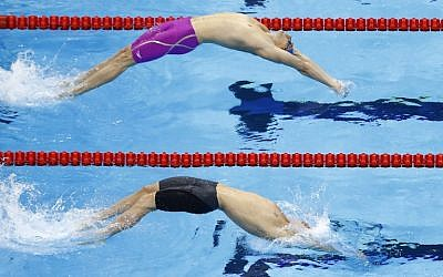 France's Camille Lacourt (top) and Australia's Mitchell Larkin compete in the Men's 100m Backstroke heats during the swimming event at the Rio 2016 Olympic Games at the Olympic Aquatics Stadium in Rio de Janeiro on August 7, 2016. (AFP PHOTO / Odd Andersen)