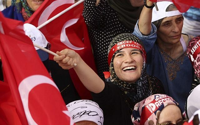 A woman reacts as people wave Turkish national flags at Kizilay Democracy Square during a rally against failed military coup, in Ankara,  August 7, 2016. (AFP/ADEM ALTAN)