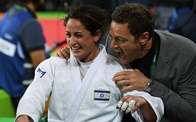 Yarden Gerbi celebrates after winning third place in the women's under-63kg judo contest at the Olympic Games in Rio de Janeiro, Brazil, on August 9, 2016. (AFP/Toshifumi Kitamura)