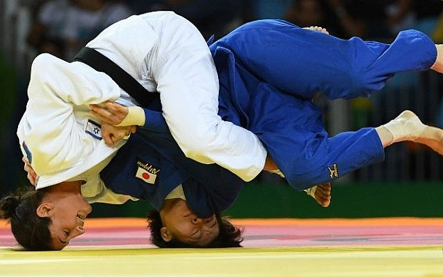 Israel's Yarden Gerbi (white) competes with Japan's Miku Tashiro during their women's -63kg judo contest bronze medal A match of the Rio 2016 Olympic Games in Rio de Janeiro on August 9, 2016. (AFP PHOTO / Toshifumi KITAMURA)