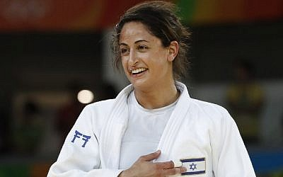 Israel's Yarden Gerbi points to the Israeli flag after defeating Japan's Miku Tashiro to win the bronze medal in the women's -63kg judo contest at the Rio 2016 Olympic Games on August 9, 2016. (AFP PHOTO/Jack GUEZ)