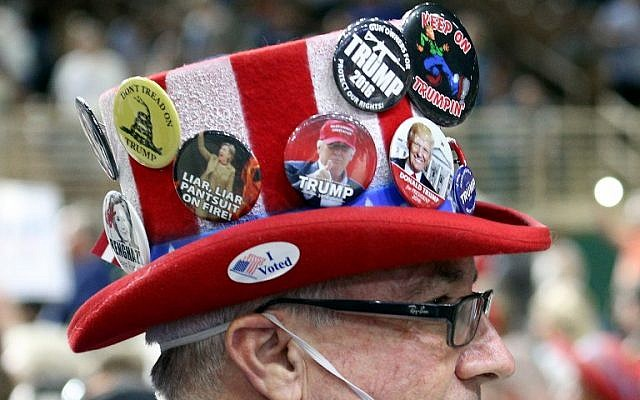 A supporter of Republican presidential candidate Donald Trump attends a campaign rally at Silver Spurs Arena, inside the Osceola Heritage Park in Kissimmee, Florida on August 11, 2016. (AFP Photo/Gregg Newton)