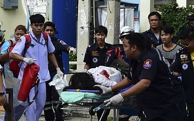 Thai rescue workers attend to an injured victim after a small bomb exploded in Hua Hin on August 12, 2016. (AFP/Munir Uz Zaman)