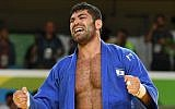 Israel's Or Sasson celebrates after defeating Cuba's Alex Garcia Mendoza to win the men's +100kg judo bronze medal at the Rio 2016 Olympic Games in Rio de Janeiro on August 12, 2016 (AFP PHOTO / Toshifumi KITAMURA)