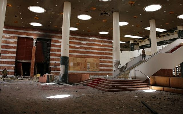 Libyan pro-government forces inspect the Ouagadougou conference center, where Islamic State (IS) had set up base, in Sirte on August 12, 2016, after pro-government forces seized it from the Islamic State. (AFP PHOTO / STRINGER)