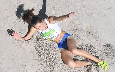 Israel's Hanna Knyazyeva competes in the Women's Triple Jump Qualifying Round during the athletics event at the Rio 2016 Olympic Games at the Olympic Stadium in Rio de Janeiro on August 13, 2016. (AFP PHOTO / Antonin THUILLIER)