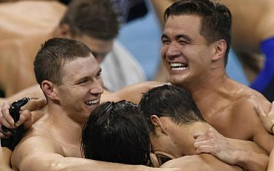 Team USA: Ryan Murphy, Cody Miller, Michael Phelps and Nathan Adrian celebrate after winning the gold in the men's swimming 4x100m Medley Relay Final at the Olympic Games in Rio de Janeiro, Brazil, on August 13, 2016. (AFP/Christophe Simon)