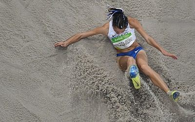 Israel's Hanna Knyazyeva-Minenko competes in the Women's Triple Jump Final during the athletics event at the Rio 2016 Olympic Games at the Olympic Stadium in Rio de Janeiro on August 14, 2016.  (AFP/ Antonin THUILLIER)