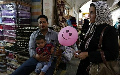 Iranians shop at the old bazaar on August 15, 2016 in the southern Iranian city of Sirjan. (Atta Kenare/AFP)