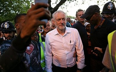 Britain's opposition Labour Party Leader Jeremy Corbyn (C) leaves after delivering a speech at a Black, Asian and minority ethnic (BAME) rally in north London on August 15, 2016. (AFP PHOTO / DANIEL LEAL-OLIVAS)