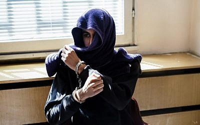 Mourad Hamyd, 20, the brother-in-law of one of the Islamic extremists behind the January 2015 attack on French magazine Charlie Hebdo, waits in a detention centre in Sofia on August 15, 2016, prior to his extradition to France. (AFP/ DIMITAR DILKOFF)