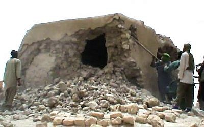 This image grab photo shows Islamist militants destroying an ancient shrine in Timbuktu, July 01, 2012. (AFP)