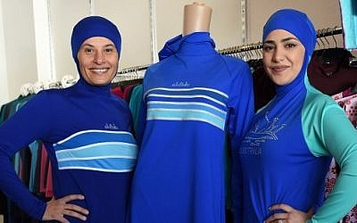 Muslim models display burkini swimsuits at a shop in western Sydney on August 19, 2016. (AFP PHOTO / SAEED KHAN)