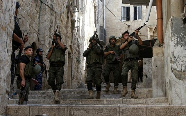 Illustrative: Palestinian security forces patrol in the West Bank city of Nablus on August 19, 2016, amid clashes. (AFP Photo/Jaafar Ashtiyeh)