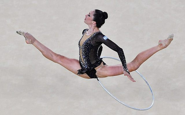 Israel's Neta Rivkin competes in the individual all-around qualifying event of the Rhythmic Gymnastics at the Olympic Arena during the Rio 2016 Olympic Games in Rio de Janeiro on August 19, 2016. (AFP PHOTO / Ben STANSALL)