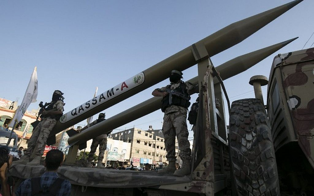 Members of the al-Qassam Brigades, the armed wing of the Hamas movement, display Qassam rockets during an anti-Israel military parade marking the second anniversary of the killing of Hamas's military commanders Mohammed Abu Shamala and Raed al-Attar on August 21, 2016, in Rafah in the southern Gaza Strip. (AFP/Said Khatib)