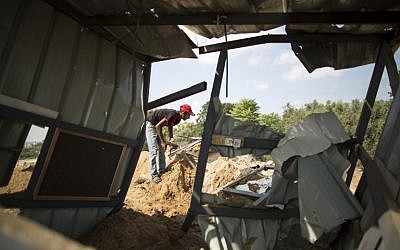 A Palestinian man inspects rubble in Beit Lahia in the northern Gaza Strip on August 22, 2016, following an Israeli airstrike the night before that targeted Hamas positions in response to a rocket fired from the Palestinian enclave that hit the Israeli city of Sderot. (Mahmud Hams/AFP)